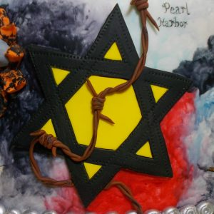 Star of David patch and barbed wire signifying the Holocaust