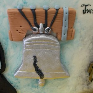The Liberty Bell in fondant relief